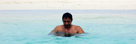 Dr. Amyn Dahya meditating in Aitutaki Waters